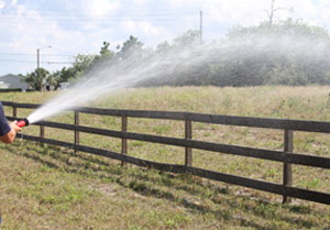 300 Gallon Sprayer Fire Hose in Action